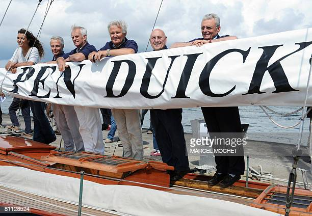 Former teammates of French sailing legend late Eric Tabarly and his daughter Marie Tabarly pose aboard Tabarly's first monohull 'Pen Duick I' during...