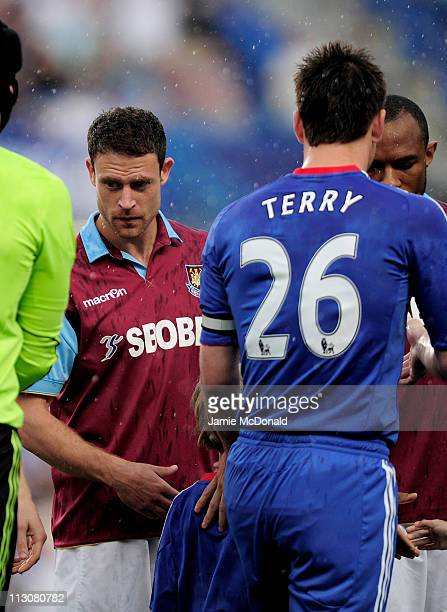 Former teammates Wayne Bridge of West Ham and John Terry of Chelsea ignore each other as the teams shake hands prior to kickoff during the Barclays...