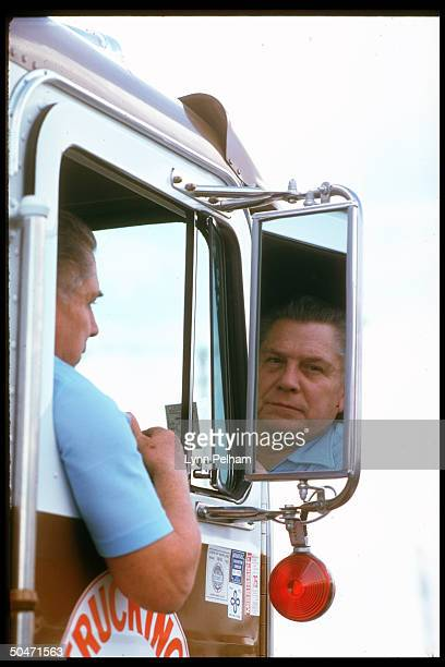 Former Teamster boss Jimmy Hoffa driving truck looking at his reflection in rearview mirror
