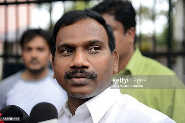 Former telecom minister A Raja gesture as he interacts with the media following his appearance in connection with the 2G spectrum scam at the CBI...