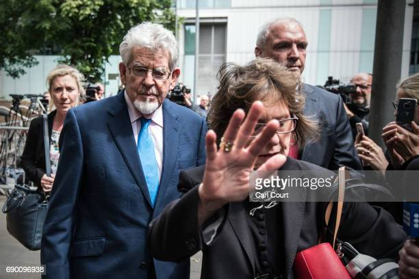 Former television entertainer Rolf Harris leaves Southwark Crown Court as his niece Jenny Harris lifts her hand in front of cameras on May 30 2017 in...