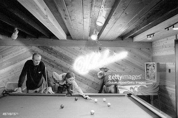 Former television producer Bruce Cooper watches as his wife Dutchborn businesswoman and former model Wilhelmina Cooper lines up a shot at the...