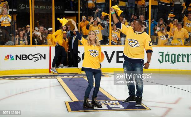 Former Tennessee Titan Eddie George and Sheryl Crow wave the rally towels prior to Game Seven of the Western Conference Second Round between the...