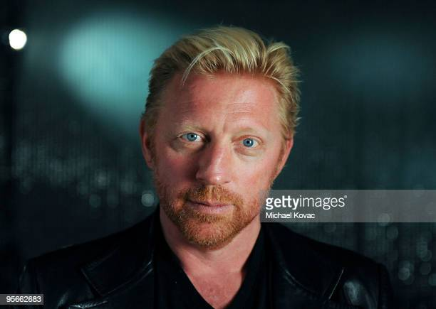 Former tennis champion Boris Becker attends a photo session at the amfAR Pokerstars Celebrity Charity Poker Tournament at Atlantis Paradise Island on...
