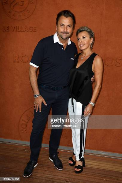 Former tennis champion Henri Leconte and his wife Florentine attend the 2018 French Open Day Seven at Roland Garros on June 2 2018 in Paris France