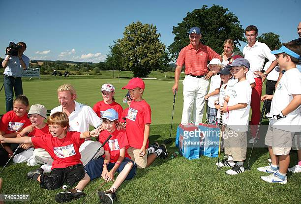 Former Tennis legend Boris Becker and Franz Beckenbauer pose with children during the opening of Hartl Golf resort June 17 2007 in Penning Germany