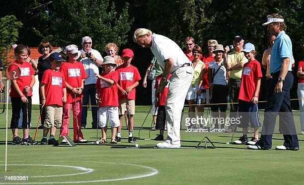 Former Tennis legend Boris Becker and golfer Bernhard Langer play golf with children during the opening of Hartl Golf resort June 17 2007 in Penning...
