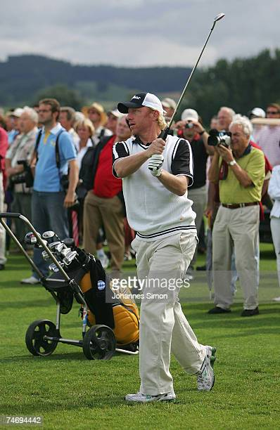 Former tennis legend Boris Becker hits a shot during the opening of Hartl Golf Resort on June 18 in Penning Germany