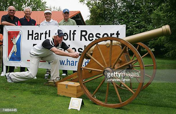 Former tennis legend Boris Becker opens the Hartl Golf Resort by firing a cannon shot with Alois Hartl HansDieter Cleven Bernhard Langer and Franz...
