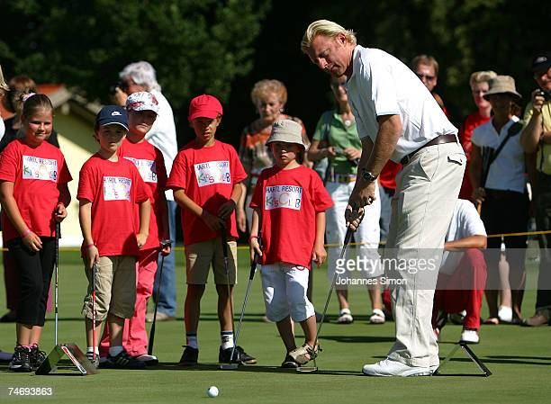 Former Tennis legend Boris Becker plays golf with children during the opening of Hartl Golf resort on June 17 in Penning Germany