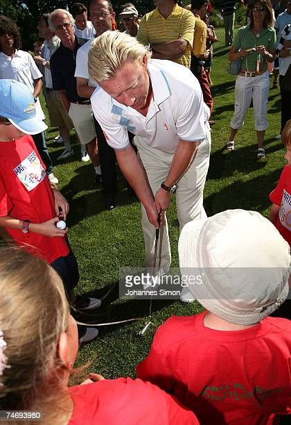 Former Tennis legend Boris Becker plays golf with children during the opening of Hartl Golf resort June 17 2007 in Penning Germany