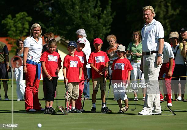 Former Tennis legend Boris Becker plays golf with with children during the opening of Hartl Golf resort on June 17 in Penning Germany