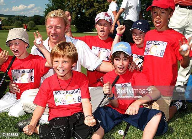 Former tennis legend Boris Becker poses with children during the opening of Hartl Golf resort on June 17 in Penning Germany