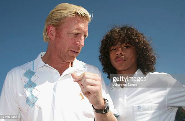 Former Tennis legend Boris Becker speaks with his son Noah during the opening of Hartl Golf resort on June 17 in Penning Germany