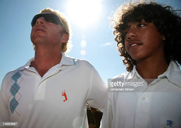 Former Tennis legend Boris Becker walks with his son Noah over the ground during the opening of Hartl Golf resort on June 17 in Penning Germany