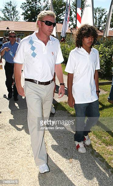 Former Tennis legend Boris Becker walks with his son Noah over the grounds during the opening of Hartl Golf resort on June 17 2007 in Penning Germany