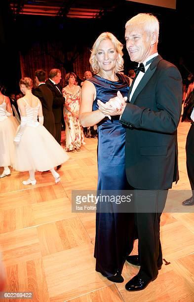 Former Tennis Player and Captain German Federation Cup Team Barbara Rittner and her boyfriend Matthias Mueller, chairman Volkswagen AG dance during...