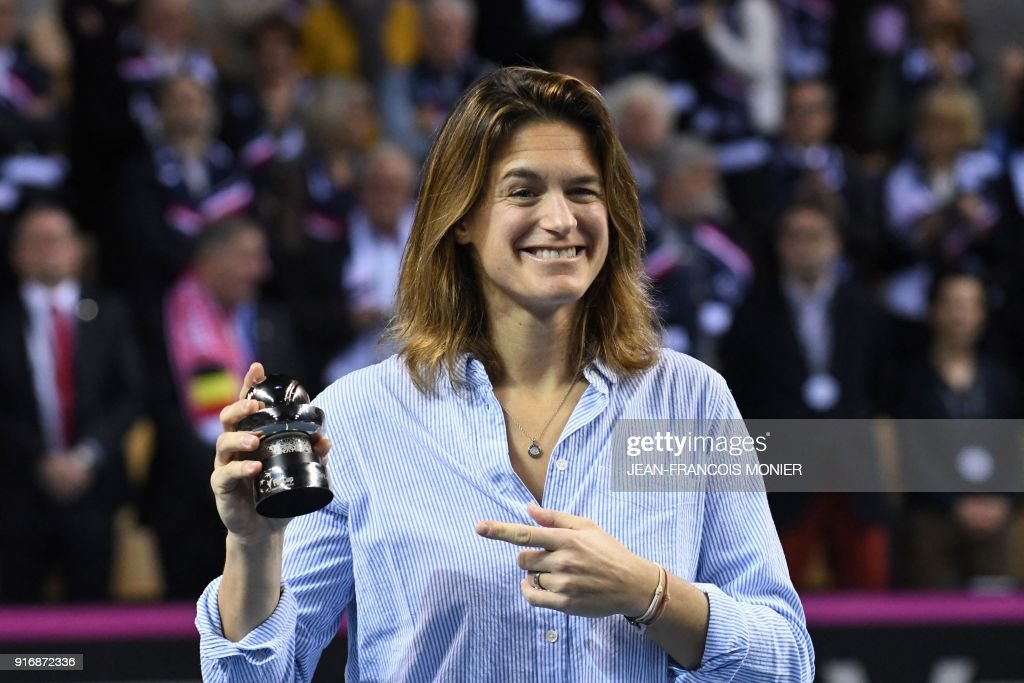 Former tennis player and former France's Fed Cup tennis coach, Amelie Mauresmo smiles after she received a prize for her 20 years of commitment to tennis, before the Fed Cup World Group first round tennis match between France and Belgium in Mouilleron-le-Captif, northwestern France, on February 11, 2018. PHOTO / Jean-Francois MONIER