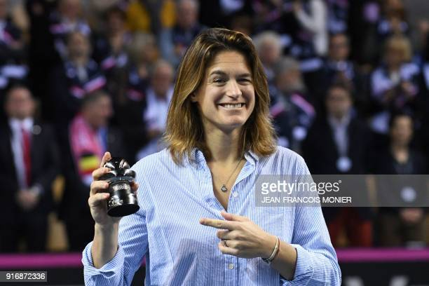Former tennis player and former France's Fed Cup tennis coach Amelie Mauresmo smiles after she received a prize for her 20 years of commitment to...