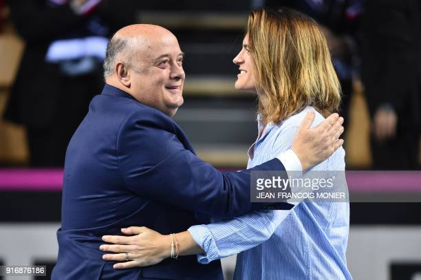 Former tennis player and former France's Fed Cup tennis coach Amelie Mauresmo hugs French Tennis Federation President Bernard Giudicelli after she...
