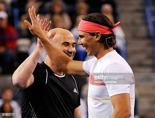 Former tennis player Andre Agassi and Rafael Nadal of Spain during Hit for Haiti a charity event during the BNP Paribas Open on March 12 2010 in...