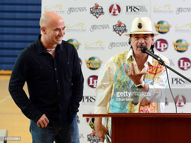 Former tennis player Andre Agassi and recording artist Carlos Santana speak as they visit the Andre Agassi College Preparatory Academy to donate more...