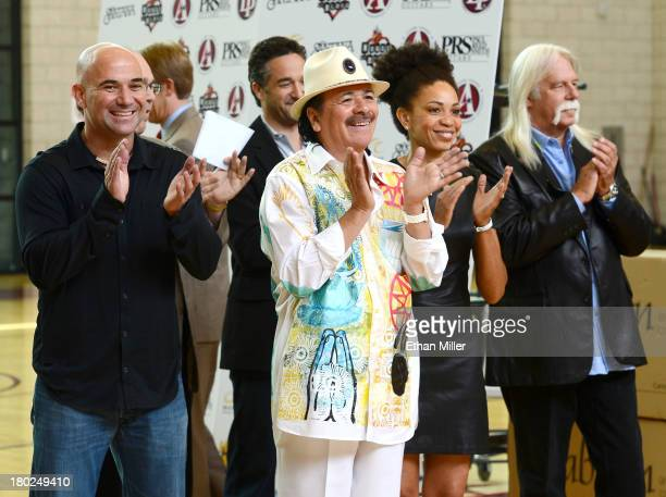 Former tennis player Andre Agassi recording artist Carlos Santana his wife drummer Cindy Blackman and Vice President of Hermes Music US Gregory...