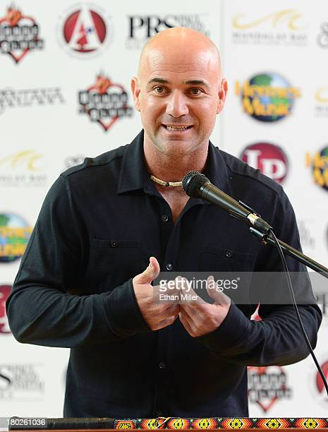 Former tennis player Andre Agassi speaks at the Andre Agassi College Preparatory Academy during a visit by Carlos Santana to donate more than 200...