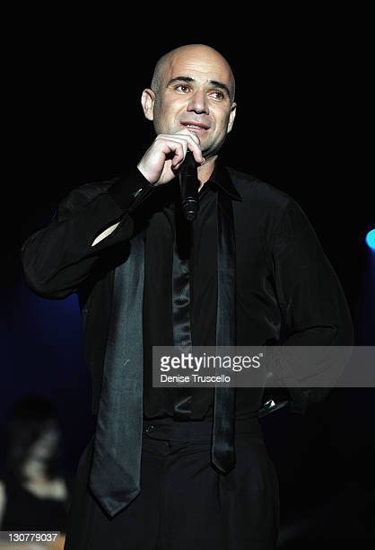 Former tennis player Andre Agassi speaks onstage during the Andre Agassi Foundation for Education's 16th Grand Slam for Children benefit concert at...