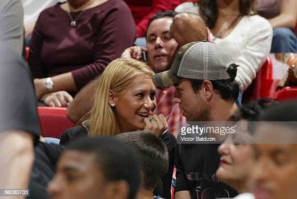 Former tennis player Anna Kournikova and boyfriend recording artist Enrique Iglesias attend the NBA game between the Miami Heat and the Indiana...