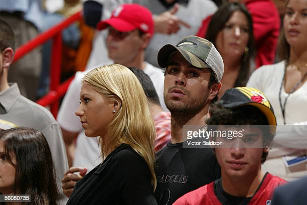 Former tennis player Anna Kournikova and boyfriend recording artist Enrique Iglesias attend the NBA game between the Miami Heat and the Indiana...
