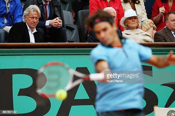 Former Tennis player Bjorn Borg watches Roger Federer of Switzerland in action during the Men's Singles Final match against Robin Soderling of Sweden...