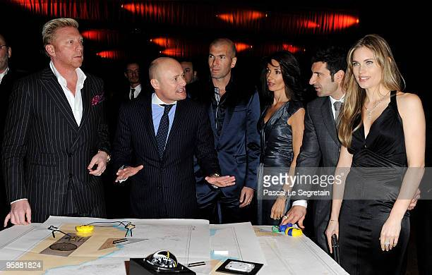 Former tennis player Boris Becker Georges Kern CEO of IWC Schaffhausen former French footballer Zinedine Zidane his wife Veronique Zidane former...