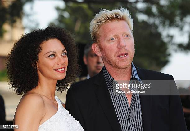 Former tennis player Boris Becker of Germany and his girlfriend Sharlely Kerssenberg attend the Amber Fashion Show and Auction held at the Meridien...