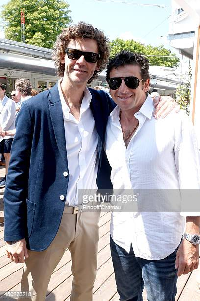 Former tennis player Gustavo Kuerten and singer Patrick Bruel attend the Men's Final of Roland Garros French Tennis Open 2014 - Day 15 on June 8,...