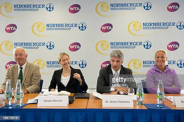 Former tennis player HansJuergen Pohmann tournament director Sandra Reichel chairman Dr Armin Zitzmann of the Nuernberger Versicherungsgruppe and...