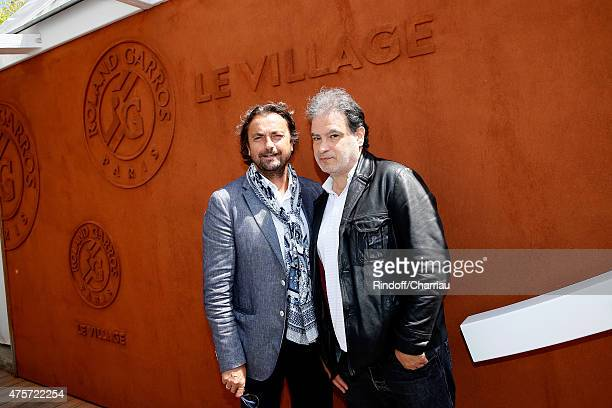 Former Tennis Player Henri Leconte and Actor Raphael Mezrahi attend the 2015 Roland Garros French Tennis Open Day Eleven on June 3 2015 in Paris...