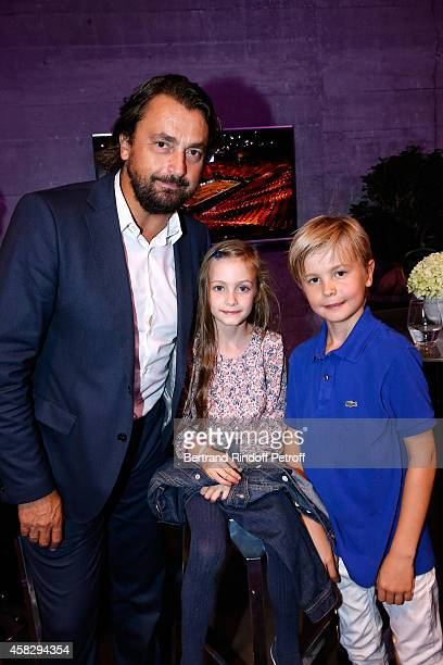 Former Tennis player Henri Leconte and his children attend the Final match during day 7 of the BNP Paribas Masters Held at Palais Omnisports de Bercy...