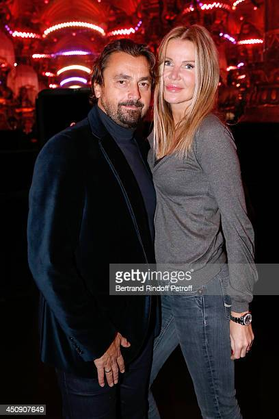 Former tennis player Henri Leconte and his wife Florentine Waters attend Coca Cola Christmas Father Waxwork Unveiling Event at Musee Grevin on...