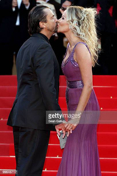 Former tennis player Henri Leconte kisses wife Florentine Leconte as they attend Biutiful Premiere at the Palais des Festivals during the 63rd Annual...