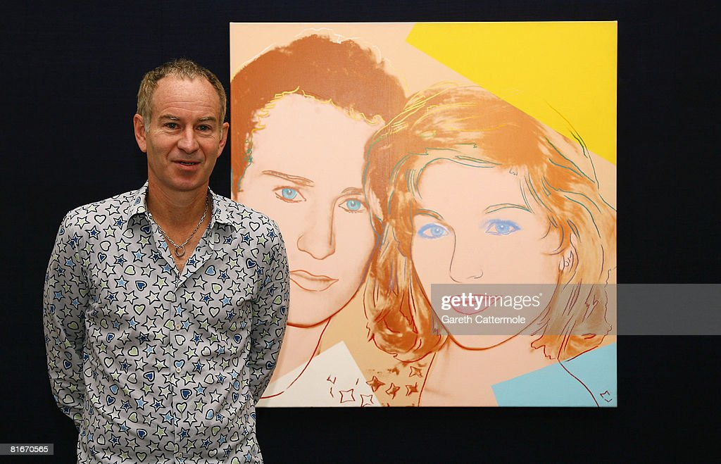 Former tennis player John McEnroe poses next to a 'Portrait of John McEnroe and Tatum O'Neal 1986' by Andy Warhol at Sotheby's on June 23, 2008 in London, England. The painting's value is estimated at GBP 250,000 - 300,000 and its proceeds will benefit the philanthropic organistation Habitat for Humanity.