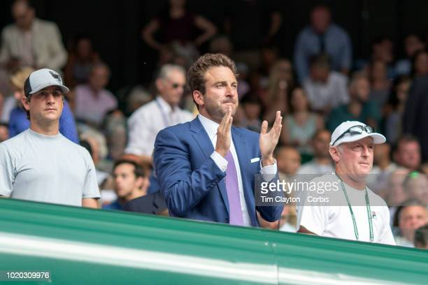 Former tennis player Justin Gimelstrob reacts while sat in the family box of John Isner of the United States during his match against Kevin Anderson...