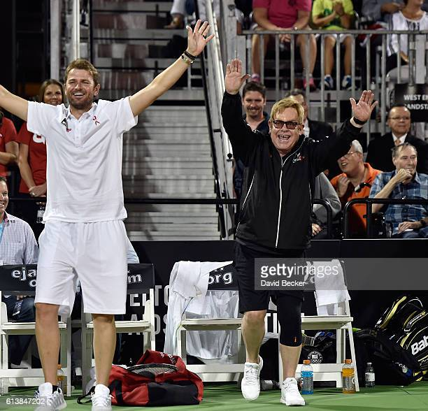 Former tennis player Mardy Fish and recording artist Sir Elton John cheer during the World TeamTennis Smash Hits charity tennis event benefiting the...