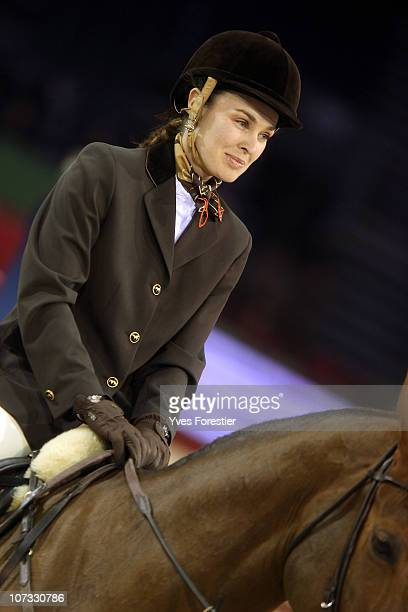 Former tennis player Martina Hingis competes in the Gucci Masters International Grand Prix Competition at Paris Nord Villepinte on December 4 2010 in...