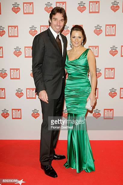 Former Tennis Player Michael Stich and wife Alexandra attend the Ein Herz fuer Kinder Gala at Ullsteinhall at the Axel Springer Building on December...