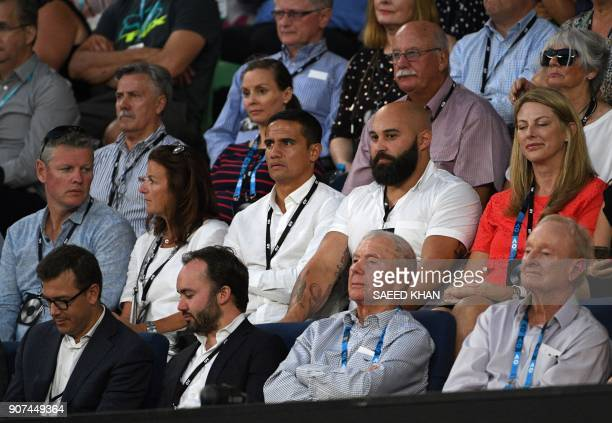 Former tennis player Rod Laver and Australia football player Tim Cahill watch the women's singles third round match between Russia's Maria Sharapova...
