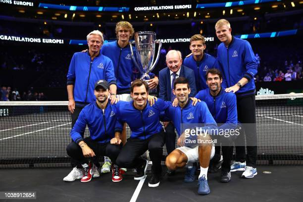Former tennis player Rod Laver of Australia and Team Europe pose with the trophy after their Men's Singles match on day three to win the 2018 Laver...