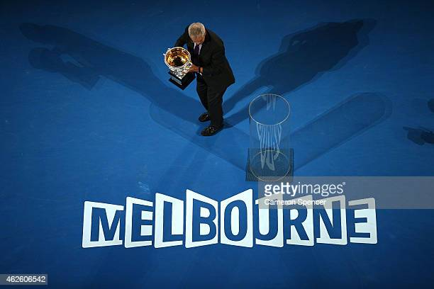 Former tennis player Roy Emerson holds the Norman Brookes Challenge Cup ahead of the men's final match during day 14 of the 2015 Australian Open at...