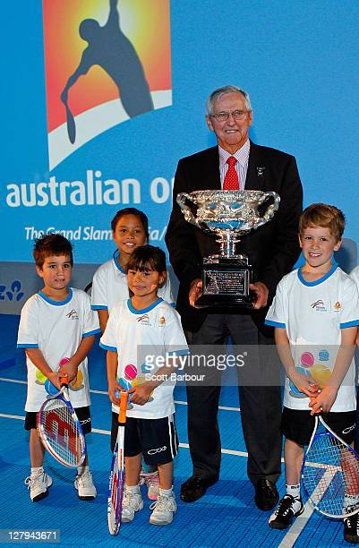 Former tennis player Roy Emerson poses with the Norman Brookes Challenge Cup and Hot Shots children during the launch of the 2012 Australian Open at...