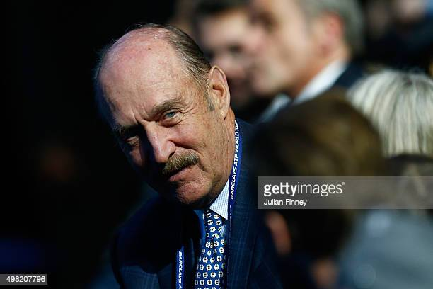 Former tennis player Stan Smith watches the men's semi final between Stanislas Wawrinka of Switzerland and Roger Federer of Switzerland on day seven...